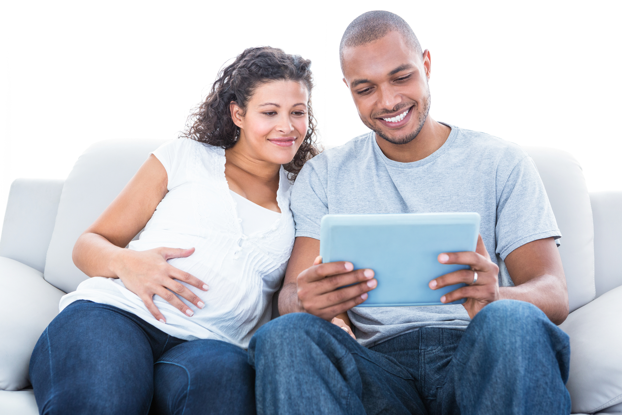 Black couple with laptop on sofa